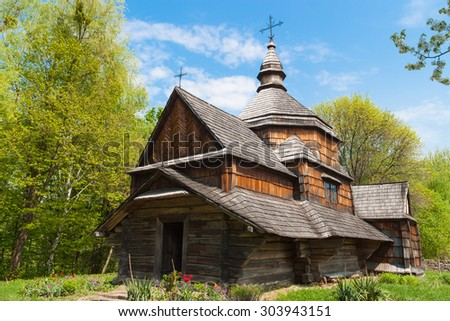 Old wooden Orthodox church in the woods. Ukraine. - stock photo