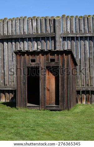 old wooden outhouse - stock photo