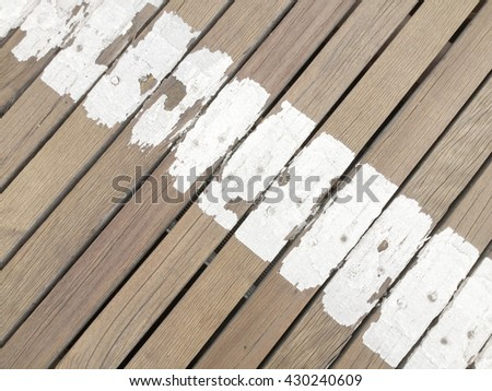 Old wooden painted and chipping paint texture - stock photo