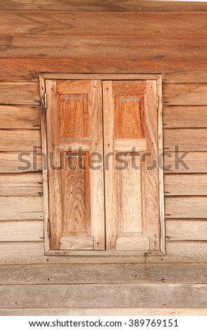 Old wooden panel and window. - stock photo