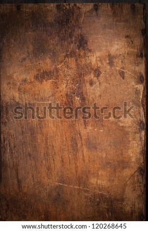 Old Wooden Panel with the Hammered Rusty Nails on the Edge - stock photo