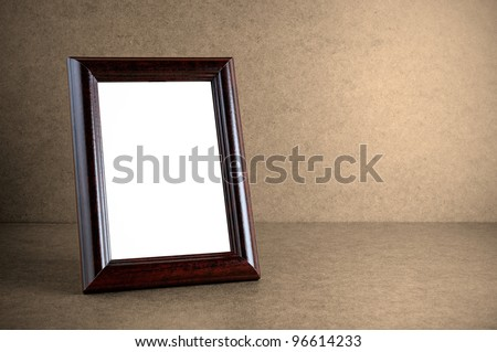 Old wooden photo frame on grunge background - stock photo