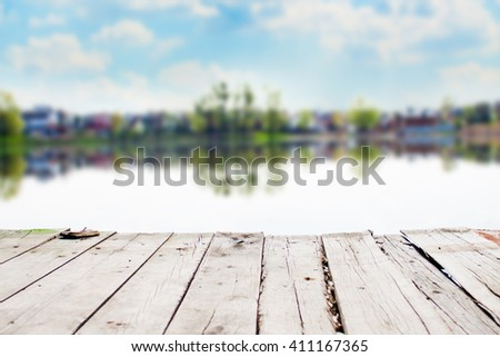 Old wooden pier on a lake at sunrise. Nature landscape - stock photo