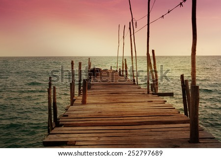 old wooden pier on the background of the sea - stock photo