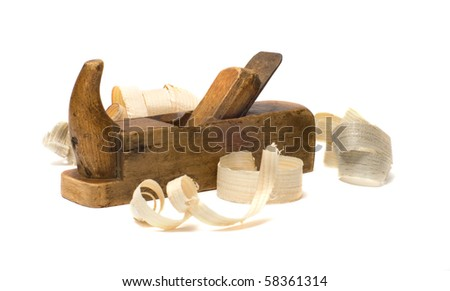 Old wooden plane and chips on a white background. - stock photo