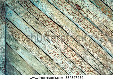 Old wooden planks with cracked blue color paint background - stock photo