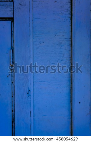 Old wooden planks with cracked color paint texture background