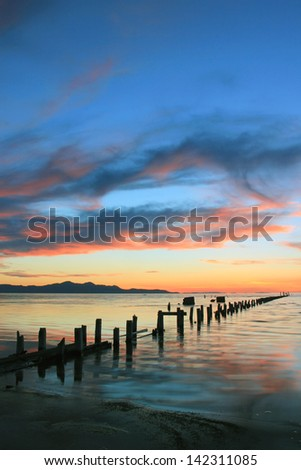 Old wooden posts leading into the Great Salt Lake, Utah, USA. - stock photo