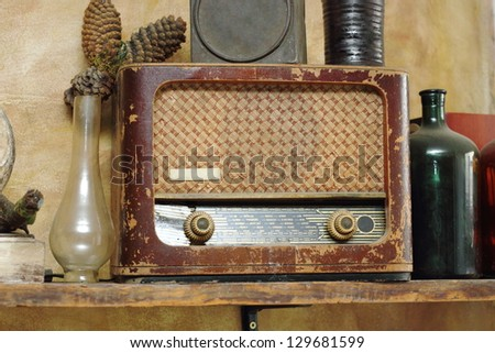 old wooden radio in a vintage setup - stock photo