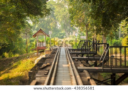 Old Wooden Railway Bridge in nature. - stock photo
