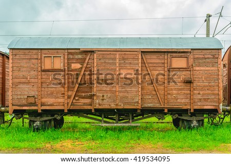Old wooden railway freight wagon. - stock photo