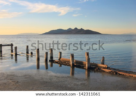 Old wooden relics on the shore of the Great Salt lake, Utah, USA. - stock photo