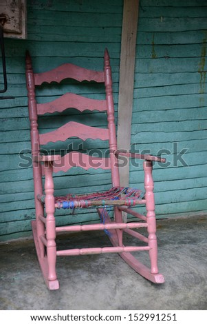 old wooden rocking chair  - stock photo