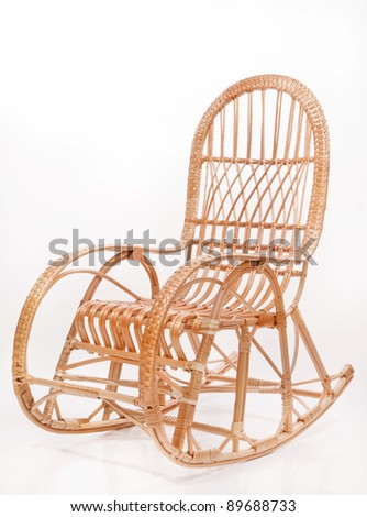 Old wooden rocking chair over white background - stock photo