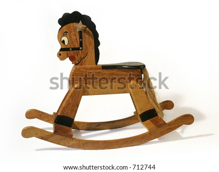 Old Wooden Rocking Horse - stock photo