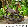 Old wooden rocking horse  in the park - stock photo