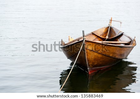 Old Wooden Row Boats Old Wooden Row Boat on Water