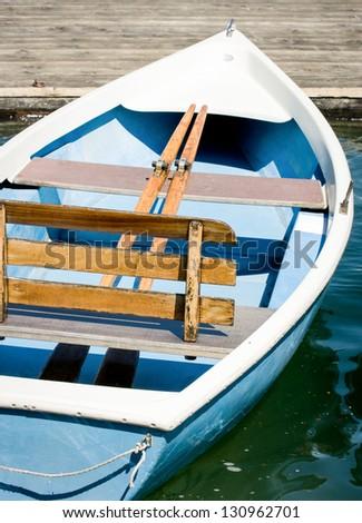 old wooden rowboat at a lake - stock photo