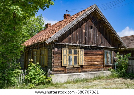 Old wooden russian Philippians house in a polish Masuria. Summer, sunny day, blue sky above.
