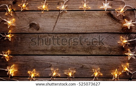 Old Wooden Rustic Christmas Background With Star Shaped Lights