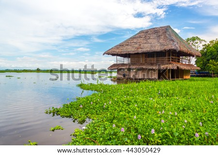 Old wooden shack floating on the Amazon River in Iquitos, Peru - stock photo