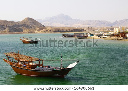Old wooden ship in the harbor of Sur, Sultanate of Oman - stock photo