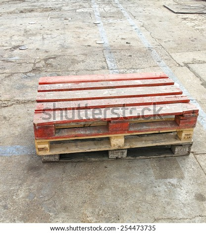 old wooden shipping pallet in a shipyard - stock photo