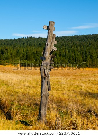 Old wooden signpost for tourists on the mountains - stock photo