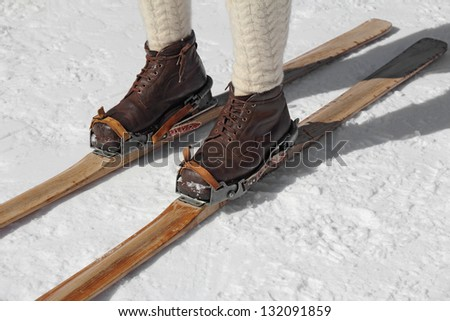 Old wooden skis and leather ski boots - stock photo