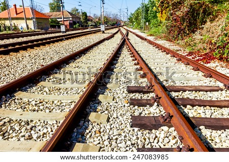 Old wooden sleepers replaced with new made of concrete sleepers on the railway track. - stock photo