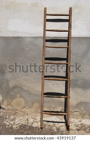 Old wooden stair against the wall of a old house - stock photo
