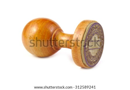 Old wooden stamp on a white background - stock photo