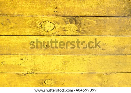 Old wooden surface painted in yellow colors - stock photo