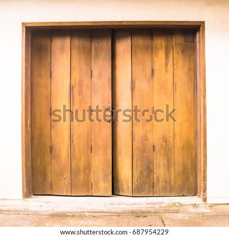Old wooden swing door background. Vintage of old wooden folding doors  texture. Antique swing - Folding Doors Stock Images, Royalty-Free Images & Vectors