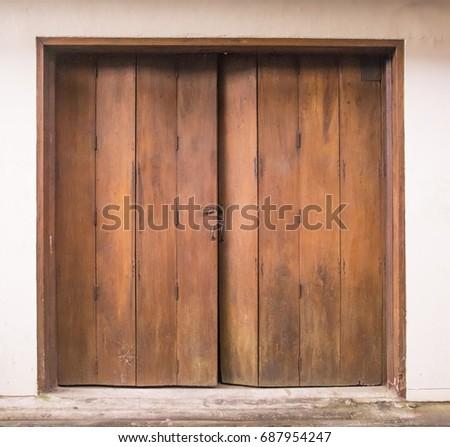 Old Wooden Swing Door Background. Vintage Of Old Wooden Folding Doors  Texture. Antique Swing