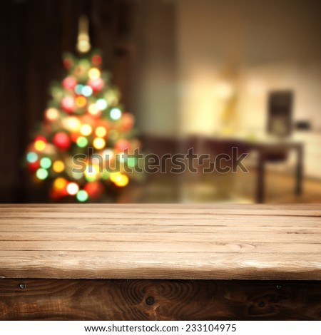 old wooden table and christmas tree  - stock photo