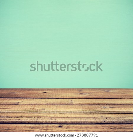 Old wooden table and wall in retro style. Shallow depth of field - stock photo