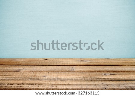 Old wooden table near wall. Shallow depth of field - stock photo
