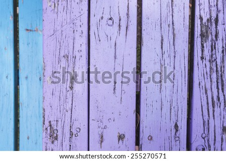 Old wooden table, varnished, purple and blue - stock photo