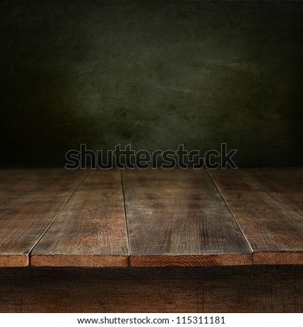 Old wooden table with dark background - stock photo