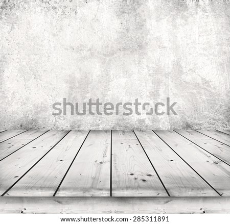 Old wooden table with stone background