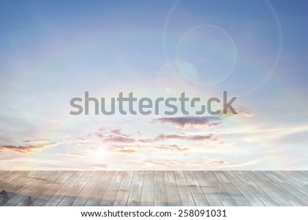 old wooden texture and double twin rainbow with lens flare in blue sky background - stock photo