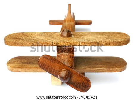 Old wooden toy airplane isolated on white background - stock photo