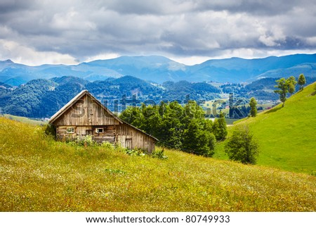 Old wooden traditional house in the mountains - stock photo
