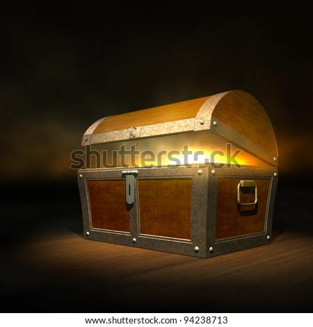 Old wooden treasure chest with strong glow from inside - stock photo