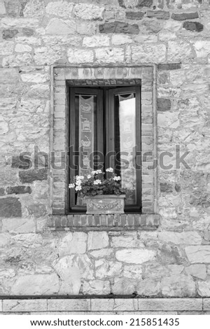Old, wooden Tuscanwindow (black and white) - stock photo