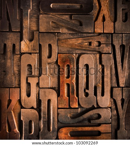 old wooden typographic blocks background - stock photo