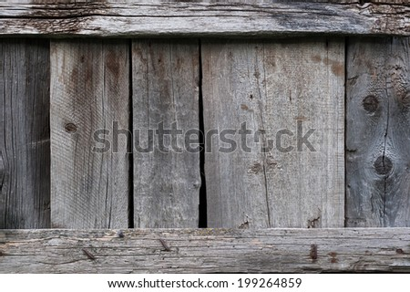 Old wooden vertical planks with horizontal slats - stock photo