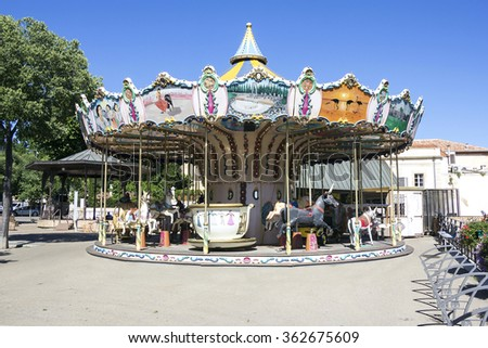 Old wooden vintage carousel in Arles, France - stock photo