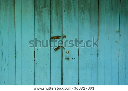 Old wooden vintage door painted in blue